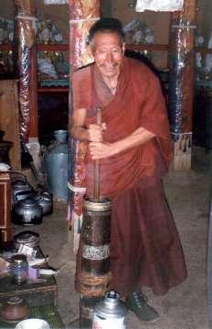 Tibetan Monk Churning Butter Tea